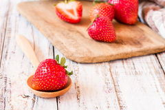 Fresh strawberries on old wooden table Royalty Free Stock Photo