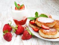 Fresh strawberries  pancakes and yogurt Stock Photos