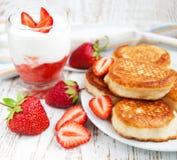 Fresh strawberries  pancakes and yogurt Royalty Free Stock Images