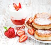 Fresh strawberries  pancakes and yogurt Royalty Free Stock Photos