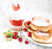 Fresh strawberries  pancakes and yogurt Royalty Free Stock Photography