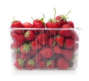 Fresh strawberries in plastic box on white. Fresh strawberries in plastic box on white background royalty free stock photo