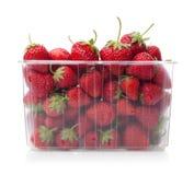 Fresh strawberries in plastic box on white. Fresh strawberries in plastic box on white background Royalty Free Stock Photo