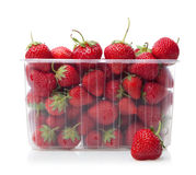 Fresh strawberries in plastic box on white. Fresh strawberries in plastic box on white background royalty free stock photos