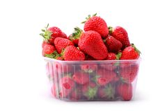 Fresh strawberries in plastic box on white background Stock Photography