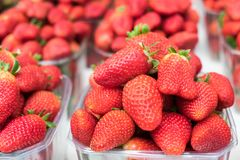 Fresh strawberries in plastic boxes sold at city market. Fresh strawberries in plastic boxes sold at city farmers market stock photo