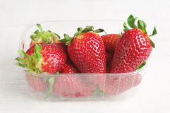 Fresh strawberries in plastic packing Stock Images