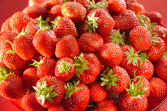 Fresh strawberries on a plate. Fresh sunny strawberries on a plate stock photos