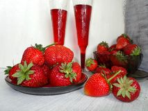 Fresh strawberries on a plate and juice in the cup Stock Photography
