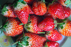 Fresh strawberries on the plate Royalty Free Stock Photos