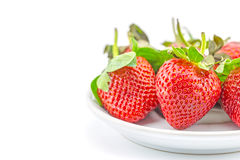 Fresh strawberries on plate Stock Images