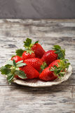 Fresh strawberries on a plate Royalty Free Stock Images