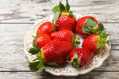 Fresh strawberries on a plate Royalty Free Stock Photos