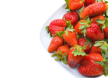 Fresh strawberries on a platter isolated on white Stock Photography