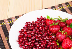 Fresh strawberries with pomegranate grains Stock Images