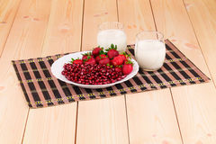 Fresh strawberries with pomegranate grains Stock Photos