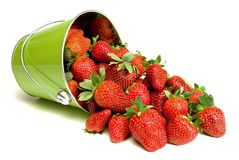 Fresh Strawberries Pouring out of Pail Stock Photography
