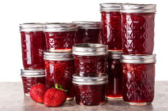 Fresh strawberries preserved in jars Royalty Free Stock Photo