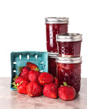 Fresh strawberries preserved in jars Stock Photos