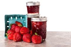 Fresh strawberries preserved in jars Stock Image