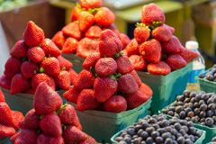 Fresh strawberries in a punnet. At the Granville Markets Vancouver stock image