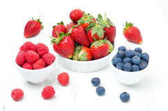 Fresh strawberries, raspberries and blueberries Stock Images