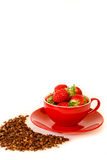 Fresh strawberries in a red bowl and chocolate granola  on white background. Stock Images