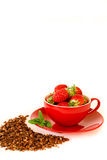 Fresh strawberries in a red bowl and chocolate granola  on white background. Royalty Free Stock Image