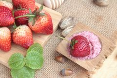 Fresh strawberries red at delicious and plum powder. Stock Images