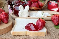 Fresh strawberries red and jam with bread. Royalty Free Stock Images