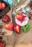 Fresh strawberries red and yogurt at delicious. Royalty Free Stock Image