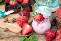 Fresh strawberries red and yogurt at delicious. Stock Images