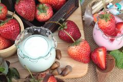 Fresh strawberries red and yogurt at delicious. Stock Photo