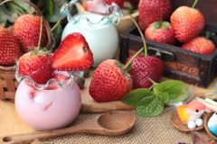 Fresh strawberries red and yogurt at delicious. Stock Photography