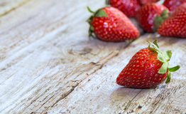 Fresh strawberries. Fresh and ripe strawberries on wooden background royalty free stock photo