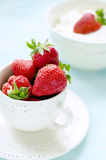 Fresh strawberries in a rustic cup Royalty Free Stock Photos