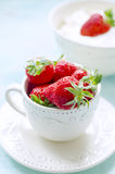 Fresh strawberries in a rustic cup Royalty Free Stock Photography