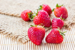 Fresh strawberries on sack Stock Images