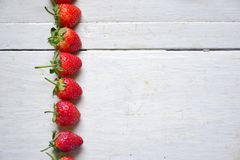 Fresh strawberries. Fresh strawberries set in row Royalty Free Stock Photo