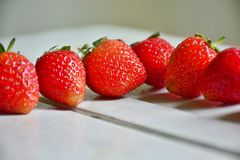 Fresh strawberries. Fresh strawberries set in row Royalty Free Stock Photos