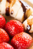Fresh strawberries with sliced banana and topped chocolate cream.  Royalty Free Stock Images