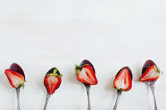 Fresh strawberries in spoons Stock Photo