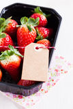 Fresh strawberries with tag Stock Images