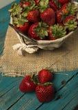 Fresh strawberries on turquoise background Royalty Free Stock Photo