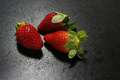 Fresh strawberries with water drops on black background Stock Photo