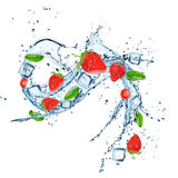Fresh strawberries with water splash. Stock Photo