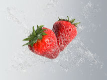 Fresh strawberries with water splash Royalty Free Stock Photography