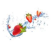 Fresh strawberries in water splash on white Stock Images