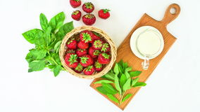 Fresh Strawberries on a white background. stop motion animation stock video footage