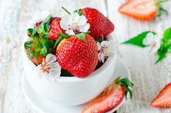Fresh strawberries in the white bowl Stock Photo